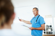 Doctor is holding a presentation; Source: istockphoto.com/Laflor Photography