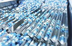 Prodcution of pills in the pharmaceutical industry; Source: istock.com/zorazhuang